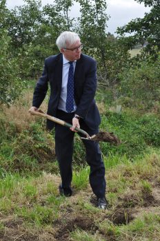 Mr Mark Menzies MP lending a helping hand at seed planting near Wildings Lane 2021